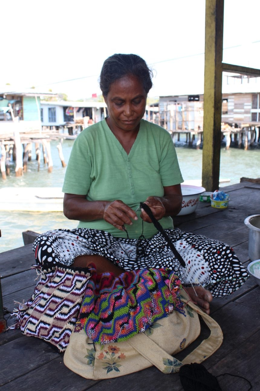 Bubu Kiri as she weaves a bilum in Gaba Gaba village, PNG.